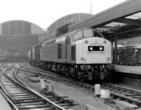 A class 40 brings a lengthy freight through Newcastle Central on a grey day in 1983.<br><br>[Colin Alexander&nbsp;//1983]