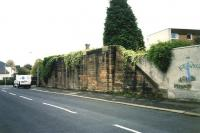 <I>Excuse me, does my abutment look big in this?</I> The remains of the former P&BDR bridge on the south side of Barshaw Drive, Paisley, now forming part of the boundary wall of the flats in the background. <br><br>[Colin Miller&nbsp;//2004]