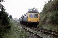 A DMU railtour carefully picks its way along the branch to Norwich Victoria coal depot late on a Saturday afternoon in October 1980. The passengers had previously been treated to a run up to Great Ryburgh and back via Dereham. Originally a passenger terminus, Norwich Victoria station closed in 1916, but the branch lingered on for goods, and latterly coal, until 1986. Predictably perhaps, the site of the coal depot now lies under a Sainsburys supermarket.<br><br>[Mark Dufton&nbsp;11/10/1980]