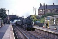 Ex-WD Austerity 2-8-0 No 90547 brings an up freight through Cumbernauld station in August 1965.<br><br>[G W Robin&nbsp;03/08/1965]