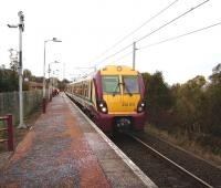 A Wemyss Bay - Glasgow Central service calls at Whinhill on 1 November formed by unit 334 015.<br><br>[David Panton&nbsp;01/11/2008]