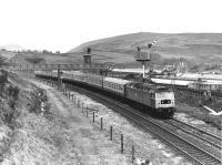 Climbing up to the Standedge tunnel at Diggle is 47415 on a Liverpool to Newcastle service running past the semaphores that were still in use at that time. 3-car Trans Pennnine 185 units provide the services now but on a much more frequent basis than in the 1980s. <br><br>[Mark Bartlett&nbsp;31/12/1980]