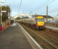 A 6-car set, with unit 334 027 leading, arrives in the western platforms at Kilwinning on 1 November 2008 with a Saturday Glasgow Central - Largs service.<br><br>[David Panton&nbsp;01/11/2008]