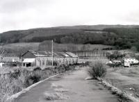 Remains of the 1882 station and shed at Fairlie Pier seen in 1985 looking back from the platforms towards the junction. The official closing date here was 31 July 1972, although the last passenger train to use the station was on 1 October 1971.<br><br>[Colin Miller&nbsp;//1985]