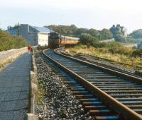 The afternon train from Dublin overtakes a jogger (<I>or should that be... </I> never mind) on the approach to Galway station in 1991. <br><br>[Bill Roberton&nbsp;//1991]