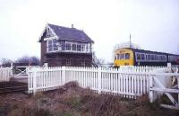 A DMU passing the signal box and level crossing alongside the closed station of St James Deeping in 1991. The train is on the former GN line between Peterborough and Spalding.<br><br>[Ian Dinmore&nbsp;//1991]