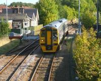 A Bridlington - Sheffield service, formed by Alphaline liveried 158 817, runs over Wansford Road level crossing, Driffield, on 1 October 2008, as it slows on the approach to the station.<br><br>[John Furnevel&nbsp;01/10/2008]