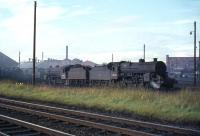 Known as <I>Horwich Moguls</I> or <I>Crabs</I>, three of these Hughes/Fowler engines are seen at Ayr MPD in August 1965. Right to left are 42740, 42909 and 42801.<br><br>[G W Robin&nbsp;08/08/1965]