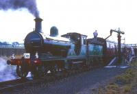 Ex-Great North of Scotland Railway 4-4-0 No 49 <I>Gordon Highlander</I> takes water on the northbound platform at Auchengray with a Branch Line Society railtour on 16 October 1965. On the right is the old bay platform that once served the former Wilsontown branch. The route shown on the ticket was <I>Glasgow Central to Glasgow St Enoch via Ponfeigh, Roslin & Bathgate</I>. <br><br>[Robin Barbour Collection (Courtesy Bruce McCartney)&nbsp;16/10/1965]