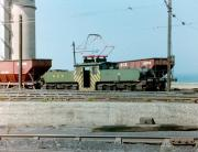 With the North Sea breaking gently on the shoreline in the background, NCB No 9 (German built AEG 1565 of 1913) stands with a train in the yards of Westoe Colliery, South Shields in 1983. Westoe was the last of the Tyneside pits to close 10 years later and No 9 is now in preservation on the Tanfield Railway. <br><br>[Colin Alexander&nbsp;//1983]