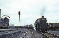Standard mogul 76096 passing Ayr MPD in 1965 with coal train for Falkland yard.<br><br>[G W Robin 08/08/1965]