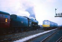 A Wigan bound DMU proceeds with caution past Stanier 8F 48773 at the head of the Manchester Rail Travel Society / Severn Valley Railway Society <i>North West Tour</i> during a photo stop at Broadfield station on the Bury - Rochdale line on 20 April 1968.<br><br>[Robin Barbour Collection (Courtesy Bruce McCartney)&nbsp;20/04/1968]