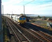 <I>So that's why they call it the West Coast Main Line.</I> 66510 and a long train of coal empties skirt Morecambe Bay while heading north at Hest Bank. The line trailing in behind the locomotive is the link from Bare Lane, now used by nuclear trains from Heysham Power Station and (from 2009) two passenger services each weekday.<br><br>[Mark Bartlett&nbsp;12/11/2008]