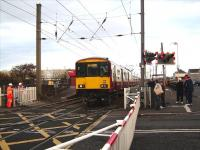 A failure of the barrier system at Stevenston results in 318 269 being flagged over the crossing against a danger signal on 12 November with a service for Ardrossan Town.<br><br>[David Panton&nbsp;12/11/2008]