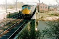 A Class 26 crosses the River Eden at Etterby shortly after leaving Carlisle in 1983 with a train for Glasgow Central via the G&SW route.<br><br>[Colin Alexander&nbsp;//1983]
