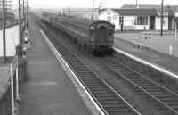 A Glasgow - Ayr DMU arrives at Barassie in August 1963. [See image 30000]<br><br>[Colin Miller&nbsp;23/08/1963]