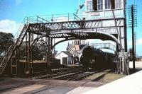 A K3 about to take a train under the signalbox and over the level crossing at the south end of Belford station, Northumberland, around 1959. [See image 16267]<br> <br><br>[John Alexander&nbsp;//1959]