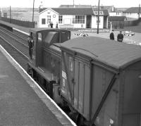 D2437, the Barassie wagon works shunter, out on a foray up the main line prior to propelling its train back into the works yard in the Summer of 1963. [Built by the G&SWR in 1902, the former Barassie carriage and wagon works became a wagon repair facility in 1928 until its eventual closure in 1974.]<br><br>[Colin Miller&nbsp;23/08/1963]