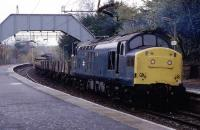 The then daily monotony of Class 303/311 EMUs is relieved at Patterton by a PW train on November 18th 1984. Leading is 37146 with 37056 at the rear. Repairs were underway at a bridge on the Neilston side of the station.<br><br>[Mark Dufton&nbsp;18/11/1984]