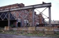 This is the huge edifice that was once Glasgow High Street Goods Station, pictured in October 1984 with six months to go before the demolition teams arrived. Photographing the site was particularly unnerving for two reasons. Firstly, the cavernous structure was full of the ghosts of the hundreds of workers who'd toiled in the building since it was built in 1904. Discarded equipment, paperwork and signage to long closed rail destinations was lying everywhere. Secondly, there appeared to be much more physical presence about in the upper reaches of the building. Not a time to be caught deep in a derelict maze with valuable camera equipment. Either end of the building had a prominent clock at roof level. The station's time had run out one day in March 1982 at 11.15.<br><br>[Mark Dufton&nbsp;04/10/1984]