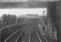 Crieff station on 4 July 1964, the last day of passenger services.  A view through a rather grimy window of the guards van as the train leaves for Gleneagles.<br><br>[John Robin&nbsp;04/07/1964]