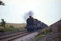 Class J-37 number 64571 hurries south from Cumbernauld with the breakdown train in August 1965.<br><br>[G W Robin&nbsp;03/08/1965]