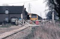The line between King's Lynn and Dereham was closed on September 9th 1968, but freight activity continued on short sections at either end. Shown here is the King's Lynn end at Middleton Towers, the first station out. This section of the line was (and is) retained for sand traffic from British Industrial Sand's transfer sidings just beyond the station. On March 29th 1980, a DMU is paying a visit as part of a west Norfolk freight lines rail tour. Apart from the absence of a signal box and signals, a photo taken at the same place in 1968 during the last days of passenger service would be little different.<br><br>[Mark Dufton&nbsp;29/03/1980]
