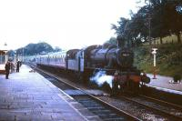 Ivatt class 2MT 2-6-0 46432 of 12D Workington shed brings a train into Cockermouth station circa 1964. After a 7 year spell at Workington, the locomotive went to Springs Branch, Wigan, from which it was eventually withdrawn by BR in May 1967. <br><br>[Robin Barbour Collection (Courtesy Bruce McCartney)&nbsp;//1964]