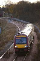 170 477 has just passed the footbridge at Alloa West with the 1041 service to Glasgow Queen Street on 19 November.<br><br>[Bill Roberton&nbsp;19/11/2008]