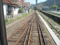 <I>Modelling challenge?</I>The Douro Valley main line is mixed gauge from the junction at Corgo to the large station at Regua, where the tracks fan out into separate yards and bays on either side of the line. This view of the complicated pointwork is from the window in the rear corridor connection of a Pocinho to Porto train approaching Regua.<br><br>[Mark Bartlett&nbsp;20/03/2008]