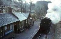 Morning commuters await the last steam - hauled train to Glasgow at Thorntonhall on the frosty morning of 15th April 1966.  Standard tank 80006 is in charge.<br><br>[G W Robin&nbsp;15/04/1966]
