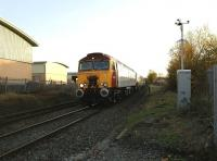 Virgin <I>Thunderbird</I> rescue locomotive 57303 <I>Alan Tracy</I> on a Pendolino drag heading for Preston at Rylands Crossing on 16 November. View is south towards Chorley station.<br><br>[John McIntyre&nbsp;16/11/2008]