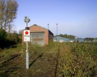 The original 1958 C&W shop at Perth New Yard in October 2008, with 1990's style Depot Protection signals. The more modern 1992(?) C&W shed stands in the distance.<br><br>[Gary Straiton&nbsp;/10/2008]