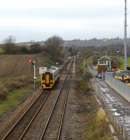 Although the station has gone the signalbox remains at Dorrington as a northbound Class 158 heads towards Shrewsbury on 19 November past an upper quadrant home signal beyond which stands a lower quadrant starter.<br><br>[John McIntyre&nbsp;19/11/2008]