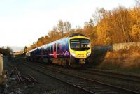 A First TransPennine class 185 looking even brighter than normal as it catches the low Autumn sun heads towards Chorley on 16 November 2008 with a service for Manchester Airport.<br><br>[John McIntyre&nbsp;16/11/2008]