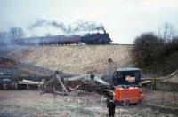 Standard tank number 80116 approaches Busby with the 17.33 from St Enoch to East Kilbride in April 1966. The colour and modus operandi of the excavator is worthy of note.<br><br>[G W Robin&nbsp;14/04/1966]