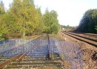 Road to nowhere at the north end of Perth New Yard in October 2008, with the main line to Inverness on the right and the former link to the Crieff line on the left. The track layout was much modified here when the loop was removed.<br> <br><br>[Gary Straiton&nbsp;/10/2008]