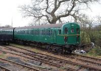 A class 207 <I>Thumper</I> DEMU repainted back into its original colours and with its old BR number stands at Hayes Knoll on the Swindon & Cricklade Railway on 22 November.<br><br>[Peter Todd&nbsp;22/11/2008]