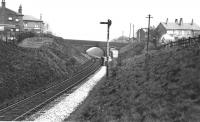 A view looking towards Bury at Brandlesholme Road Halt. The distant signal will be for the home signal protecting Tottington junction and the East Lancashire main line north of Bury Bolton St. [See image 21238] for a view of a train climbing through the cutting under the bridge. Side contact electric 3rd rail still in place. Print credited to N R Knight<br><br>[W A Camwell Collection (Courtesy Mark Bartlett)&nbsp;05/02/1952]