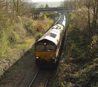 EWS 66201 passing the disused Ashton Gate station, Bristol, on the Portbury Line with a train of coal empties on 24 November 2008<br><br>[Peter Todd&nbsp;24/11/2008]