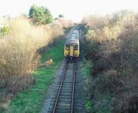 Now a single track branch with limited services but once a double track overhead electrified commuter line that also carried significant freight traffic. This is the Heysham branch looking towards Morecambe from near the ferry port as 156452 heads for Lancaster on a boat train service. <br><br>[Mark Bartlett&nbsp;25/11/2008]