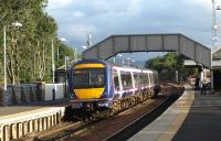 Dalmeny station looking south in October 2008 with a Fife circle service boarding at the up platform.<br><br>[Brian Forbes&nbsp;/10/2008]