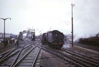 Ex-LNER B1 4-6-0 no 61342 of Eastfield shed brings <I>Scottish Rambler No 5</I> back from Ardrossan's Montgomerie Pier on 10 April 1966 towards the platforms of Ardrossan North station, from which the photograph was taken. The line over the level crossing below the footbridge provided a link with the G&SW system which ran to Winton Pier.<br><br>[Robin Barbour Collection (Courtesy Bruce McCartney)&nbsp;10/04/1966]