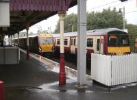 334 022 runs into platform 1 at a wet Milngavie station on 9 August, thus clearing the single line section for the train on platform 2 to depart with a service for High Street.   <br><br>[David Panton&nbsp;09/08/2008]