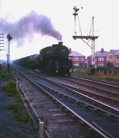 Ivatt class 4 2-6-0 no 43138 approaching Ashington with northbound coal empties in 1966, the year the locomotive arrived at North Blyth shed.<br> <br><br>[Robin Barbour Collection (Courtesy Bruce McCartney) //1966]