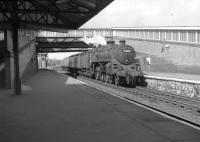 BR Standard class 5 4-6-0 no 73005 of Corkerhill shed runs into a smart looking Dalry station in July 1963 with an <I>extra</I> for Largs. [See image 29973] for the same scene forty seven years later. <br><br>[Colin Miller&nbsp;19/07/1963]