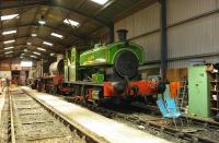 Interior shot of the Swindon & Cricklade Railway shed at Hayes Knoll on 29 November. Engines seen are Barclay 0-6-0ST <I>Salmon</I> and Hunslet 0-6-0ST <I>Gunby</I>, the latter being the precursor to the Austerity class J94, with the original design having been modified by Riddles for wartime use.<br><br>[Peter Todd&nbsp;29/11/2008]