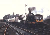 <I>Scottish Rambler No 5</I> is about to leave Ayr station on 10 April 1966 behind B1 no 61342. The railtour is seen here alongside a service DMU.  <br><br>[Robin Barbour Collection (Courtesy Bruce McCartney)&nbsp;10/04/1966]