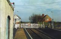 A quiet Easter Saturday morning at Thorpe Culvert station on the Skegness Branch looking past the level crossing and signal box towards Firsby. <br><br>[Mark Bartlett&nbsp;02/04/1994]