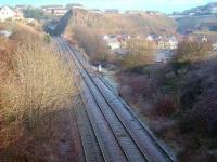 View north towards Kinghorn tunnel with part of the trackbed of the short, steeply-graded, Pettycur Harbour branch visible on the right. Opened in 1849, the line was subsequently cut back to serve a bottle factory, located where the modern housing now stands. The branch closed completely in the 1960s and the old factory was eventually demolished in 1984.<br> <br><br>[David Panton&nbsp;01/12/2008]